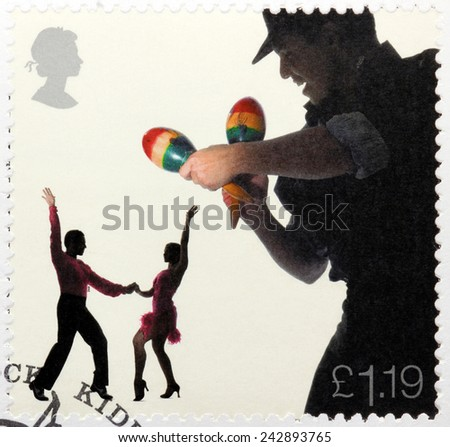 UNITED KINGDOM - CIRCA 2006: A stamp printed by GREAT BRITAIN shows Maraca Player and Salsa Dancers, circa 2006 - stock photo