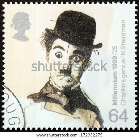 "UNITED KINGDOM - CIRCA 1999: a stamp printed by UNITED KINGDOM shows image portrait of famous English comic actor and filmmaker Sir Charles Spencer ""Charlie"" Chaplin, circa 1999. - stock photo"