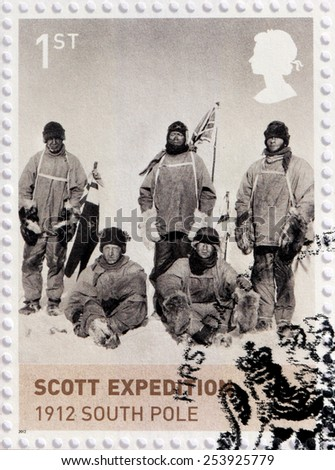 UNITED KINGDOM - CIRCA 2012: A stamp printed by UNITED KINGDOM shows Scott Expedition at South Pole. Royal Navy officer Robert Falcon Scott who led two Antarctic expeditions, circa 2012. - stock photo