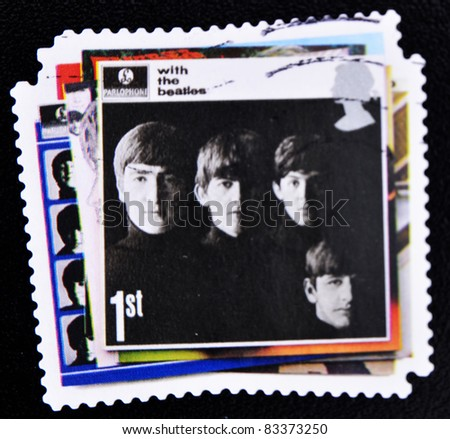 UNITED KINGDOM - CIRCA 2007: A stamp printed in British showing The Beatles Pop Group Album Cover, circa 2007 - stock photo