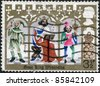 "UNITED KINGDOM - CIRCA 1973: A stamp printed in England, is shown Illustrations for Christmas carol ""Good King Wenceslas"", Page and peasant, circa 1973 - stock photo"