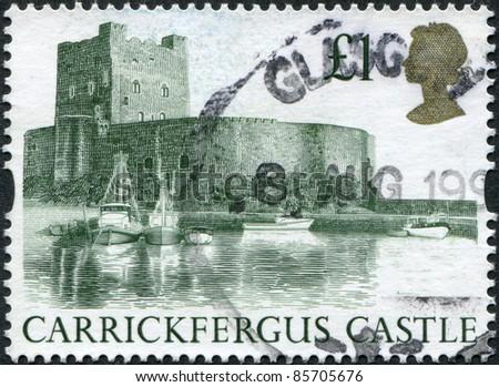 UNITED KINGDOM - CIRCA 1992: A stamp printed in England, shows Carrickfergus Castle, circa 1992 - stock photo