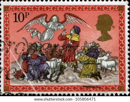 UNITED KINGDOM - CIRCA 1973: A stamp printed in England, shows Christmas: Angel appearing before the shepherds, circa 1973