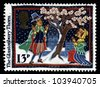UNITED KINGDOM - CIRCA 1986: A stamp printed in England, shows Christmas scene: Glastonbury Thorn next to a symbolic tree, circa 1986. - stock photo