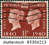 UNITED KINGDOM - CIRCA 1940: A stamp printed in England, shows Queen Victoria and King George VI, circa 1940 - stock photo