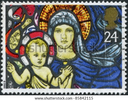 UNITED KINGDOM - CIRCA 1992: A stamp printed in England, shows the Christmas: Madonna and Child, St. Mary's Church, Bibury, circa 1992 - stock photo
