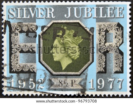UNITED KINGDOM - CIRCA 1977: A stamp printed in Great Britain honoring Silver Jubillee shows Queen Elizabeth II, circa 1977 - stock photo