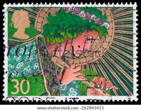 UNITED KINGDOM - CIRCA 1998: A stamp printed in Great Britain shows an angel, circa 1998 - stock photo