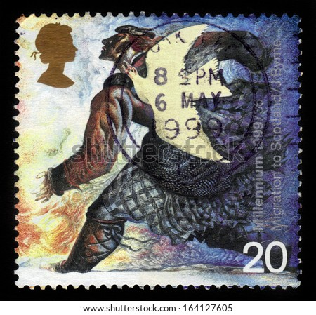 UNITED KINGDOM - CIRCA 1999: A stamp printed in Great Britain shows dove and norman settler (medieval migration to Scotland) , millennium series, circa 1999