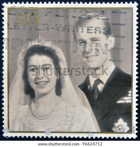 UNITED KINGDOM - CIRCA 1997: A stamp printed in Great Britain shows Queen Elizabeth II and Prince Philip on the day of the wedding, circa 1997 - stock photo
