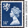 UNITED KINGDOM - CIRCA 1988: A stamp printed in Scotland shows Queen Elizabeth II and Royal Arms of Scotland, circa 1988. - stock photo