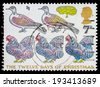 UNITED KINGDOM - CIRCA 1977: a stamp printed in the Great Britain shows the Carol The Twelve Days of Christmas showing French Hens, Turtle Doves and Partridge in a Pear Tree, circa 1977   - stock photo