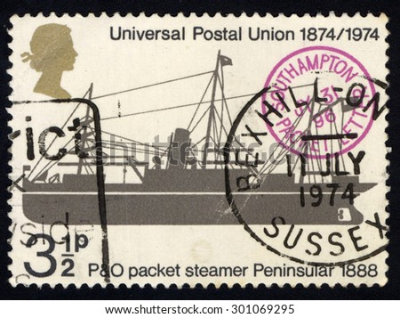 UNITED KINGDOM - CIRCA 1974: A stamp printed in the United Kingdom celebrating the Centenary of the Universal Postal Union showing the P&O Packet Steamer Peninsular, circa 1974 - stock photo