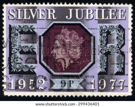 UNITED KINGDOM - CIRCA 1977: A stamp printed in the United Kingdom commemorating the Silver Jubilee of Queen Elizabeth II, circa 1977 - stock photo