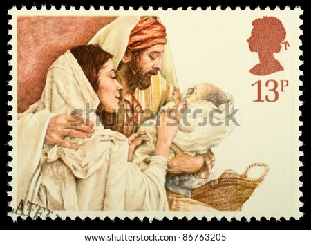 UNITED KINGDOM - CIRCA 1984: A stamp printed in the United Kingdom shows a Christmas postage stamp with Mary, Joseph and Baby Jesus, circa 1984 - stock photo