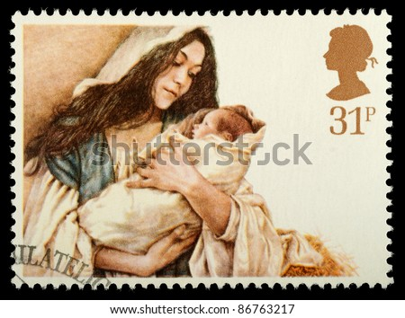 UNITED KINGDOM - CIRCA 1984: A stamp printed in the United Kingdom shows a Christmas postage stamp with Virgin Mary and Baby Jesus, circa 1984