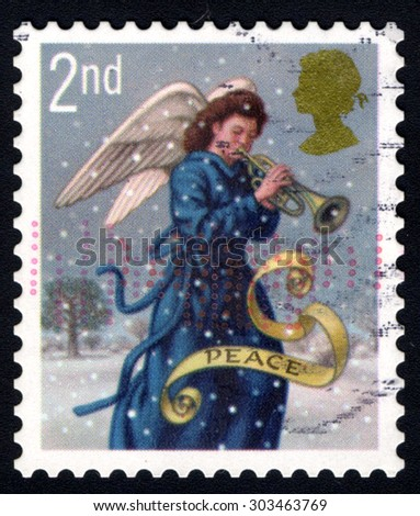 UNITED KINGDOM - CIRCA 2007: A stamp printed in the United Kingdom shows Angel playing Trumpet, with the message Peace, circa 2007 - stock photo