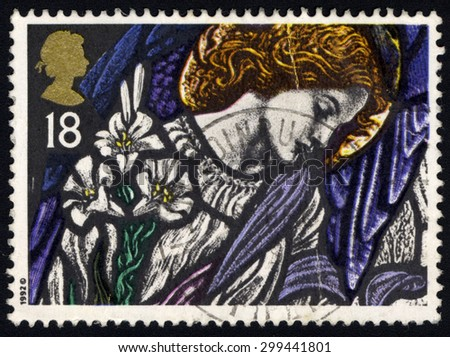 UNITED KINGDOM - CIRCA 1992: A stamp printed in the United Kingdom shows The Angel Gabriel, St James, Pangbourne, Stained Glass Windows, circa 1992.  - stock photo