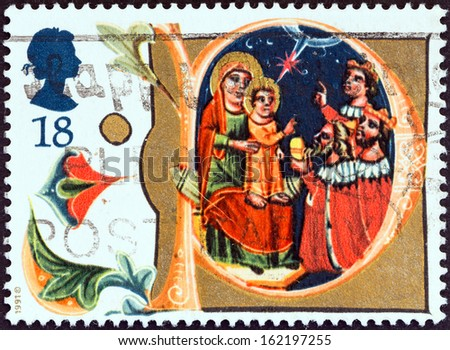 """UNITED KINGDOM - CIRCA 1991: A stamp printed in United Kingdom from the """"Christmas """" issue shows Adoration of the Magi, Manuscript in Bodleian Library, Oxford, circa 1991.  - stock photo"""