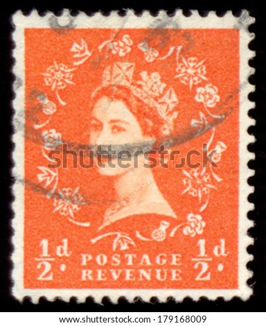 UNITED KINGDOM - CIRCA 1952: A stamp printed in United Kingdom shows a portrait of Queen Elizabeth II, circa 1952. - stock photo