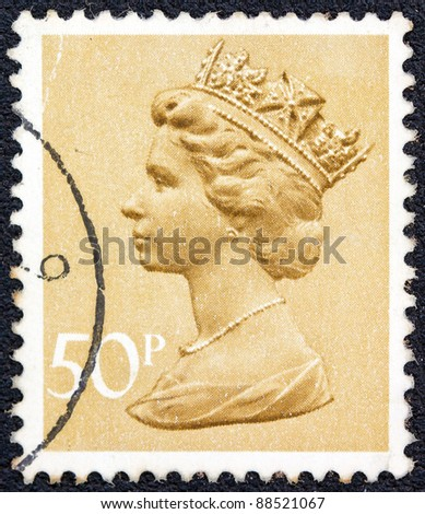 UNITED KINGDOM - CIRCA 1971: A stamp printed in United Kingdom shows a portrait of Queen Elizabeth II, circa 1971. - stock photo