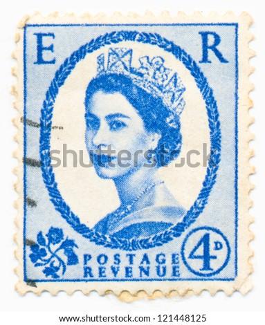 UNITED KINGDOM - CIRCA 1953: A stamp printed in United Kingdom shows portrait of Queen Elizabeth II, circa 1953 - stock photo