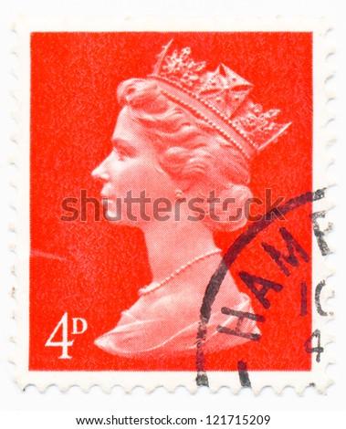 UNITED KINGDOM - CIRCA 1969: A stamp printed in United Kingdom shows portrait of Queen Elizabeth II, circa 1969 - stock photo
