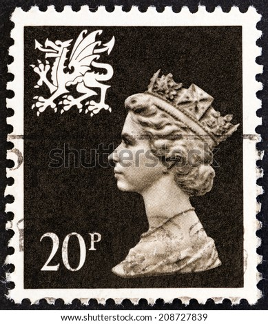UNITED KINGDOM - CIRCA 1989: A stamp printed in United Kingdom shows Queen Elizabeth II and Royal Arms of Wales, circa 1989.  - stock photo