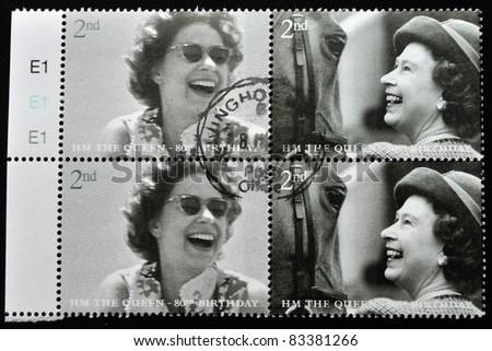 UNITED KINGDOM - CIRCA 2002: A stamp printed in United Kingdom shows Queen Elizabeth II, serie, circa 2002. - stock photo