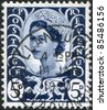 UNITED KINGDOM - CIRCA 1958: A stamp printed in Wales & Monmouthshire, shows Queen Elizabeth II, Welsh Dragon, circa 1958 - stock photo