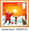 UNITED KINGDOM - CIRCA 2004: A stamp (Scott 2008 2244b) printed in the United Kingdom shows image of Santa Claus looking at rising sun, circa 2004 - stock photo