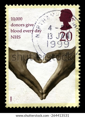 UNITED KINGDOM - CIRCA 1998: A used British Postage Stamp celebrating the 10,000 donors who give blood to the NHS every day, circa 1998. - stock photo
