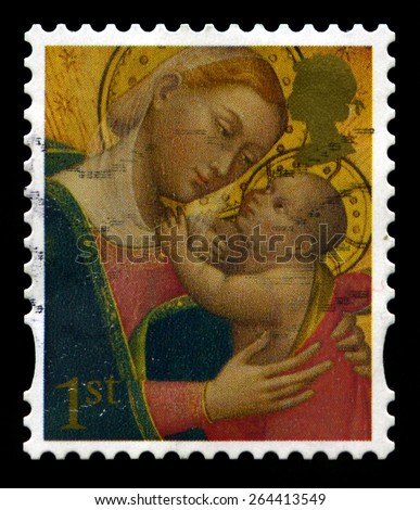 UNITED KINGDOM - CIRCA 2007: A used British Postage Stamp depicting a religious illustration of Madonna and Child, circa 2007. - stock photo