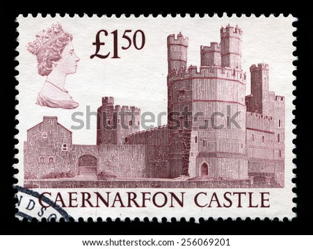 UNITED KINGDOM - CIRCA 1993: A used British postage stamp depicting an image of Caernarfon Castle in Wales, circa 1993. - stock photo