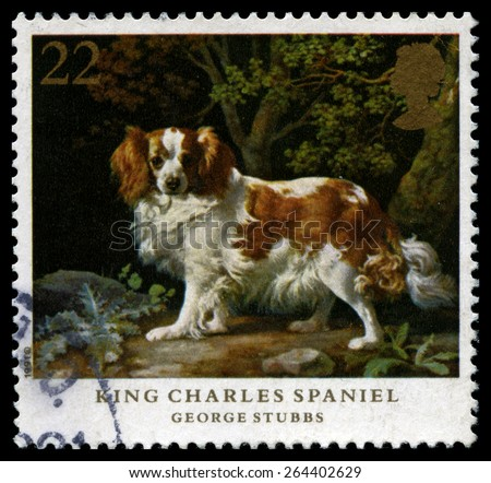 UNITED KINGDOM - CIRCA 1991: A used British Postage Stamp showing a King Charles Spaniel, painting by George Stubbs, circa 1991.  - stock photo