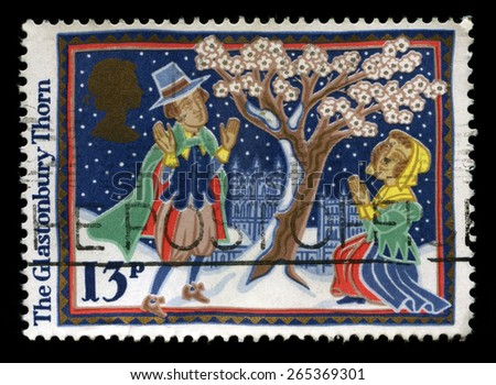 UNITED KINGDOM - CIRCA 1986: A used Christmas Postage Stamp depicting an illustration of the historic Glastonbury Thorn Tree, circa 1986. - stock photo