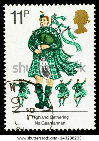 UNITED KINGDOM - CIRCA 1976: A used postage stamp printed in Britain celebrating British Cultural Traditions, showing Scots Piper with Bagpipes, circa 1976 - stock photo