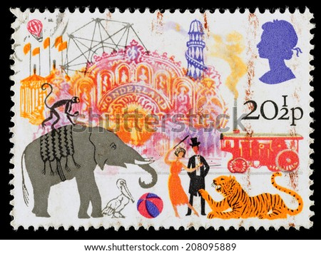 UNITED KINGDOM - CIRCA 1983: A used postage stamp printed in Britain celebrating British Fairs showing Circus and Amusement Rides - stock photo
