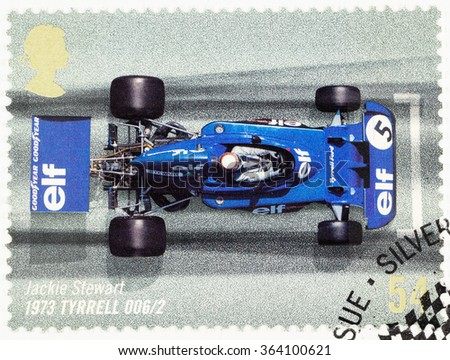 UNITED KINGDOM - CIRCA 2007: A used postage stamp printed in Britain celebrating the 50th Anniversary of the British Grand Prix showing Jackie Stewart in an 1973 Tyrrell - stock photo