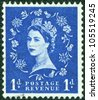 UNITED KINGDOM - CIRCA 1960: An English Used First Class Postage Stamp printed in UNITED KINGDOM showing Portrait of Queen Elizabeth in blue, circa 1960. - stock photo