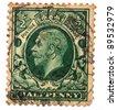 UNITED KINGDOM - CIRCA  1924: An English Used Halfpence Brown Postage Stamp showing Portrait of King George V, circa 1924 - stock photo