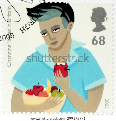 UNITED KINGDOM - CIRCA AUGUST, 2005: A stamp printed by GREAT BRITAIN shows image of Teenage Boy Eating Apple. Changing Tastes in Britain. - stock photo