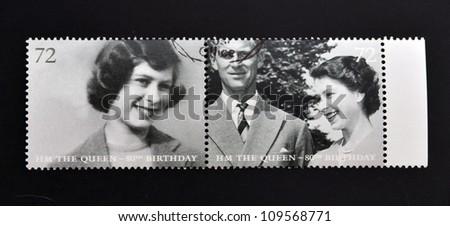 UNITED KINGDOM - CIRCA 2002: Collection stamps printed in Great Britain shows Queen Elizabeth II, circa 2002. - stock photo