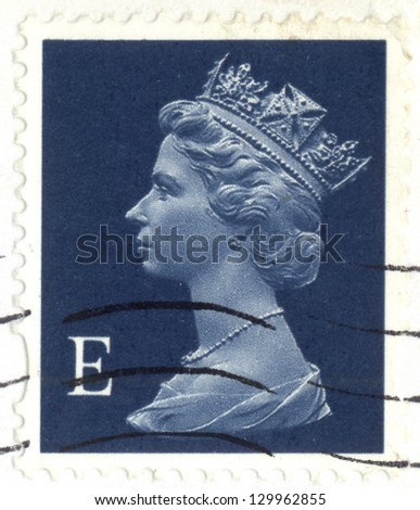 UNITED KINGDOM - CIRCA 2000 to 2003: An English Used First Class Postage Stamp, showing Portrait of Queen Elizabeth 2nd, circa 2000 to 2003. - stock photo