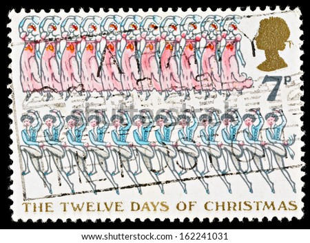 UNITED KINGDOM - CIRCA 1977: Used Christmas Postage Stamp depicting the Carol The Twelve Days of Christmas showing Twelve Lords and Eleven Ladies, circa 1977 - stock photo