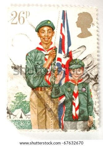 UNITED KINGDOM - DATE UNKNOWN: a stamp printed in the United Kingdom shows image of two Scouts, circa unknown - stock photo
