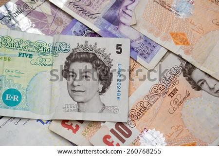 United Kingdom Five, Ten and Twenty Pound Notes - Money background - stock photo
