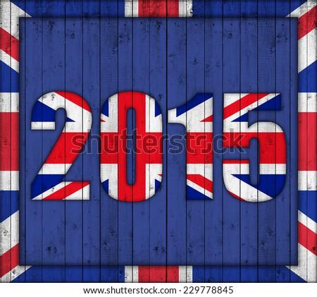 united kingdom flag,number 2015 and blue wood background - stock photo