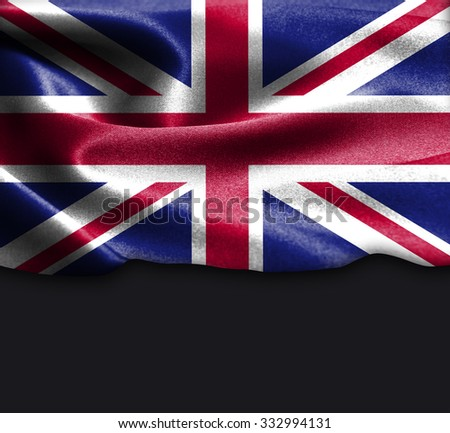 United Kingdom flag on smooth silk texture Dark Background Space for Text - stock photo