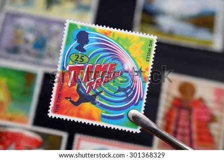 UNITED KINGDOM - JUNE 6, 1995: Macro photo of a British stamp about the book The Time Machine written by the science fiction writer Herbert George Wells - stock photo